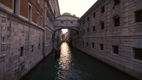 Gondola passing under the bridge of sighs at dusk Footage