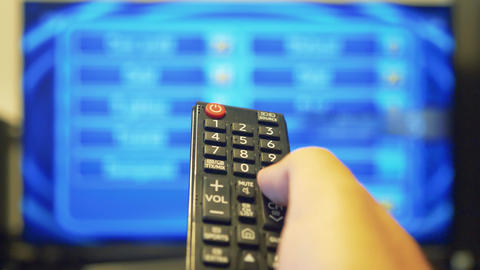 Using the tv remote to change the tv channels Live Action