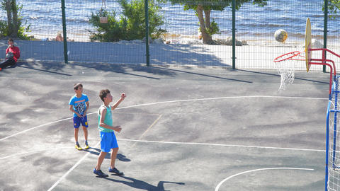 Teenagers practice in the game of basketball. Slow motion Footage