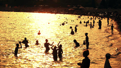 Slow motion shot of crowded beach in the evening GIF