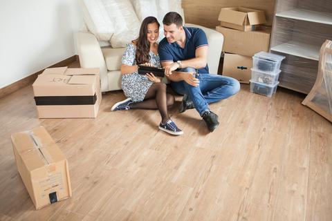 Happy couple thinking about decoration in new home Photo