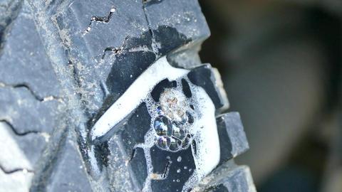 Bubble leak inspection for car tire Footage