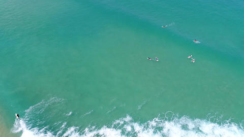 Aerial view of people enjoying surfing sports Footage