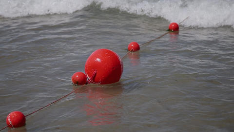 Buoys in sea water on Adriatic sea coast in Slovenia near the town of Piran Live Action