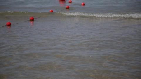 Buoys in sea water on Adriatic sea coast in Slovenia near the town of Piran Footage