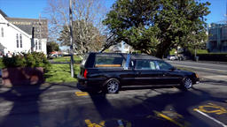 Shot of hearse arriving or leaving a funeral ビデオ