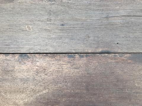 vintage natural light brown wooden board with many cracks Photo