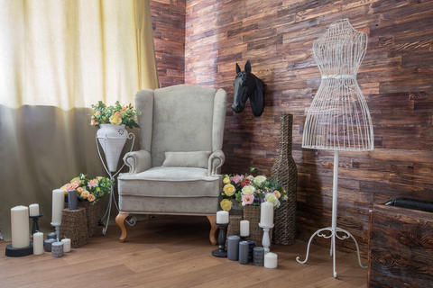 Cozy design room with a chair, candles and flowers Photo