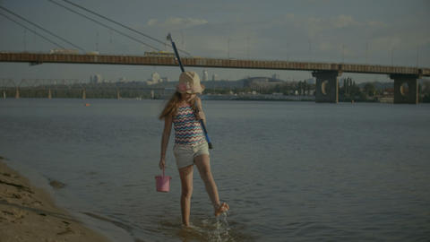 Joyful little angler walking after fishing on river Footage