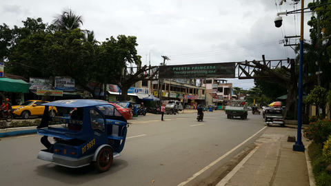 Busy street and entrance to Puerto Princesa Live Action