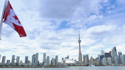 4K Toronto Skyline from Lake Ontario with CN Tower and Canadian Flag Footage