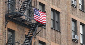 4K American Flag Hangs on a Fire Escape Footage