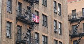 4K American Flag on a Fire Escape Footage