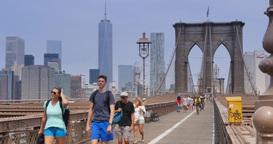 4K Tourists Walk Across the Brooklyn Bridge as Bikers Pass By Footage