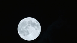 Timelapse Supermoon From Behind Night Clouds Footage