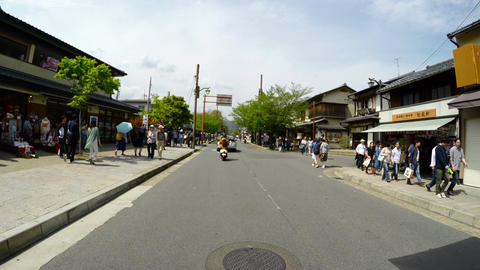 Driver POV through the crowded shopping arcade of Arashiyama Footage