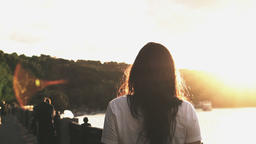 Girl on the embankment with sunset Footage