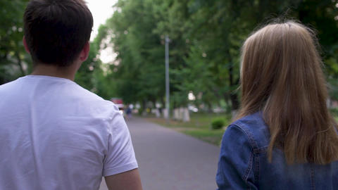 Boy and girl walk together at the park Live Action