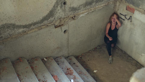 Drug addict descends the stairs in an abandoned building Live Action