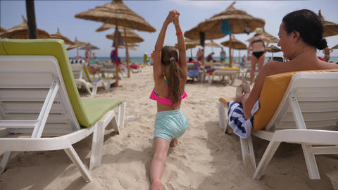 Girl teenager training yoga asana on summer beach at sea background Footage
