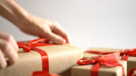 Put and arrange Christmas gift box on white background Footage