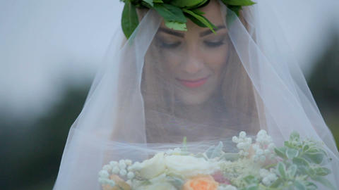 Beautiful bride under a veil with a bouquet of flowers. Mysterious image 영상물