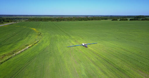 aerial view plain fields with trailed sprayer Live Action
