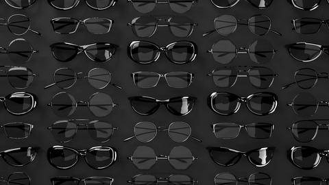 Many Black Glasses On Black Background Animation