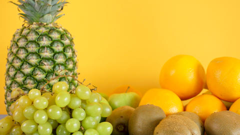 Healthy and organic exotic fruits on yellow background GIF