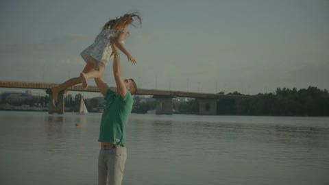 Joyful father throwing up in the air his daughter Footage