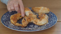 Home made snacks. Hand is grabbing homemade french croissants Footage