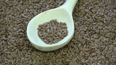 Rotating wooden spoon on flax seeds Live Action