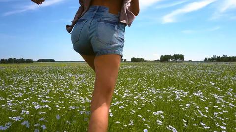 backside girl runs on buckwheat field to horizon Footage