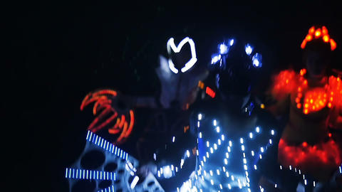 fantastic show with dancers in led light costumes on ice arena Footage
