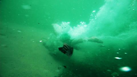 Underwater Shot Of Adult Person Diving Into Pristine Natural Swimming Poll Live Action