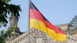 German Flag In Front of The Reichstag in Berlin, Germany Fluttering In The Wind Footage
