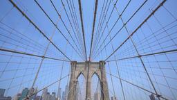 4k moving shot of walking along the Brooklyn Bridge in New York City Footage