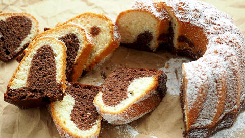 Traditional homemade marble cake. Sliced marble bundt cake on paper Live Action