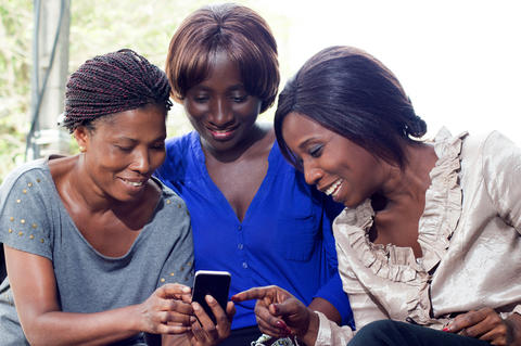 young women happy to discover mobile technology Photo