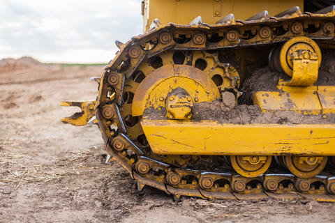 Crawler construction equipment in yellow color フォト