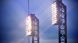 Stadium Lights Shine at Dusk with Lens Flares Footage