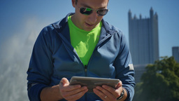4K Man with iPad Watches Sporting Event on his iPad Footage