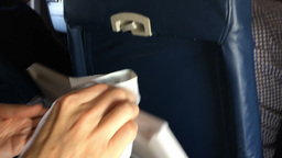 Man Cleans Airplane Seat Tray Table Footage