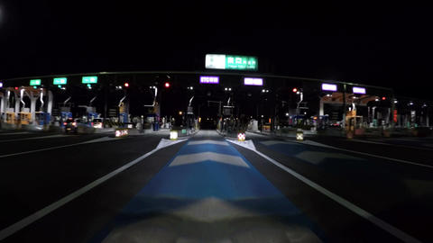 POV wide view entering the ETC gate at Tokyo interchange on the Tomei expressway Footage