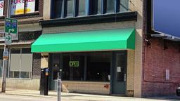Generic City Storefront Establishing Shot Green Awning Footage
