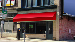 Generic City Storefront Establishing Shot Red Awning Footage