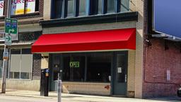 Generic City Storefront Establishing Shot Red Awning Footage