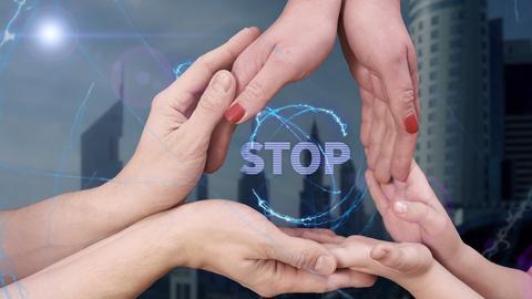Men's, women's and children's hands show a hologram Stop Photo