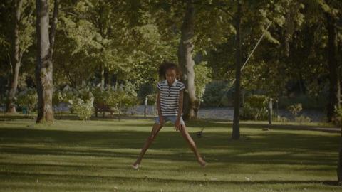 Flexible cute african american girl doing splits Footage