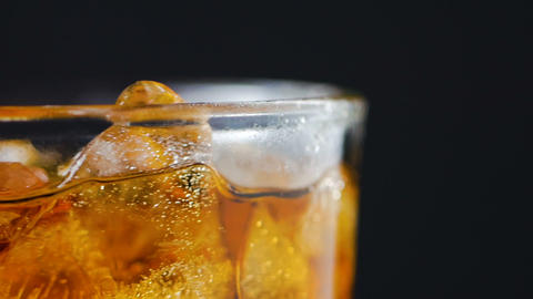 Air bubble and ice and liqueur brandy in the glass GIF